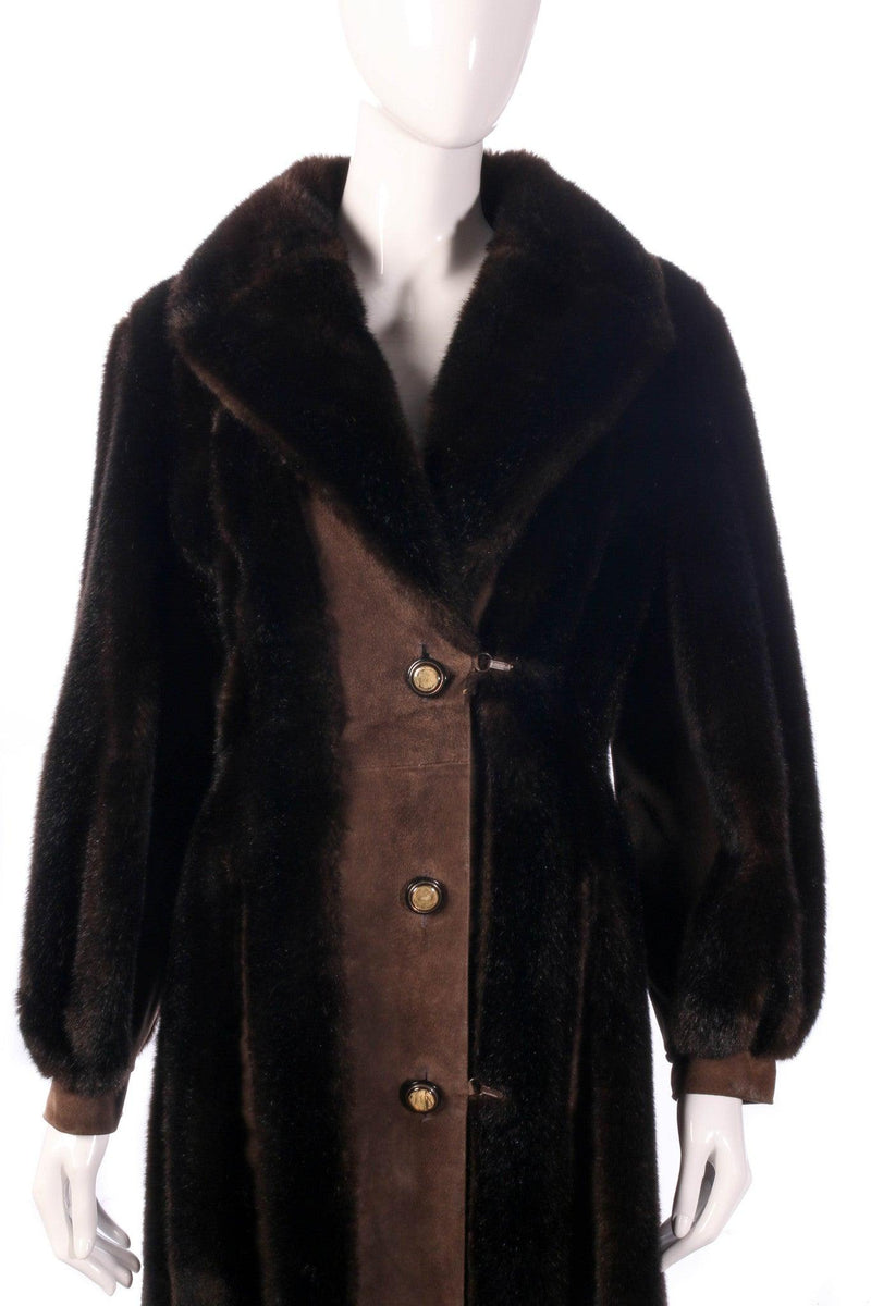 Fur and suede panelled coat detail