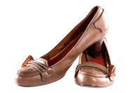Brown leather shoes with toggle detail on the toe