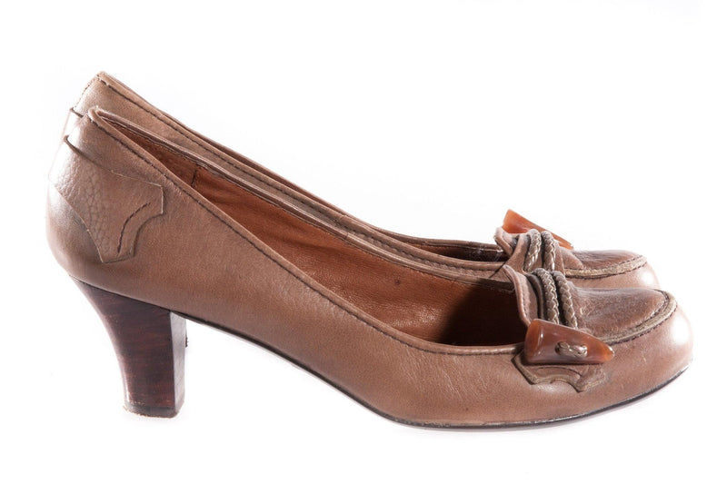 Brown leather shoes with toggle detail on the toe side