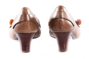 Brown leather shoes with toggle detail on the toe back