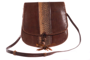Brown leather handbag with tassel front