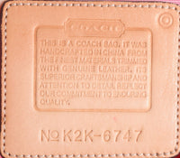 Coach small pink and brown handbag label