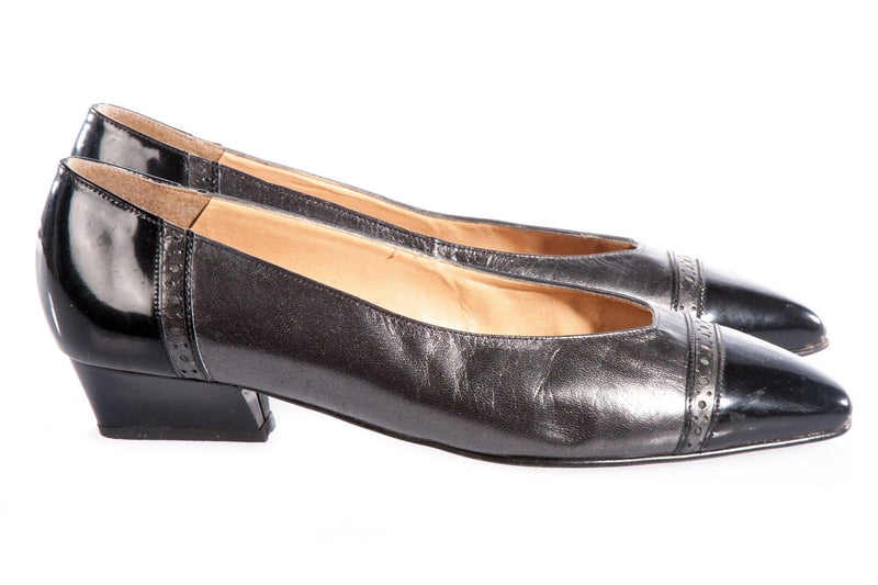 Black and metallic flat shoes side