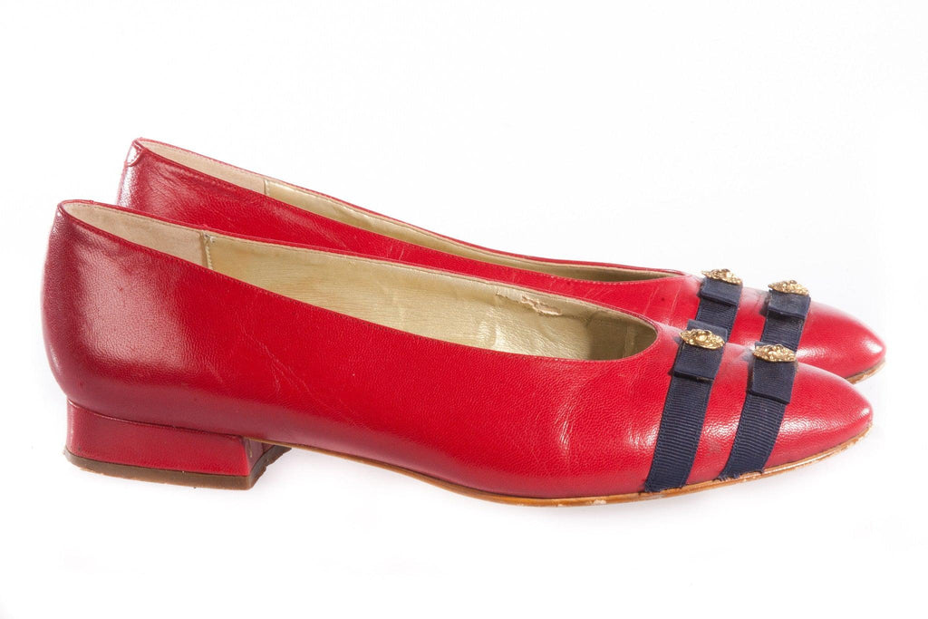 Red patent leather shoes with blue ribbon detail side