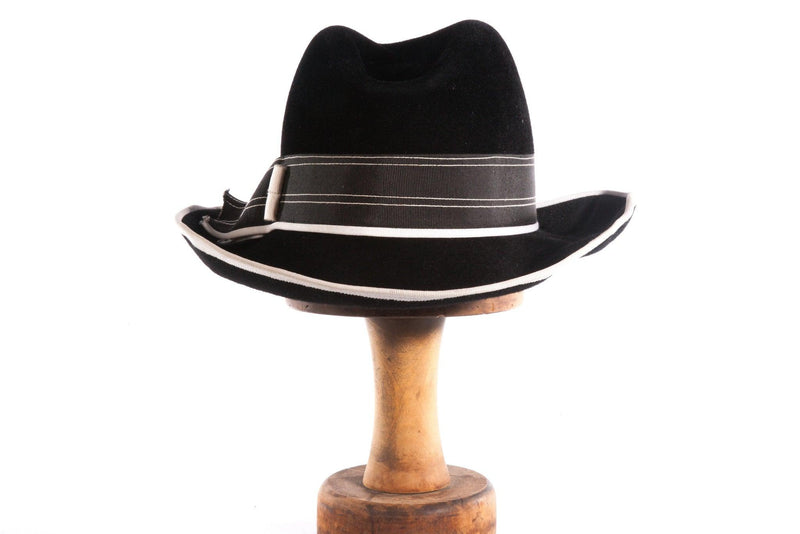 Black trilby style hat with white detail