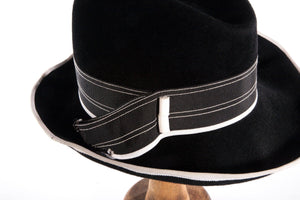 Black trilby style hat with white detail detail
