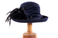 Navy blue hat with feather detail