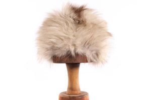 Cream and brown fur hat