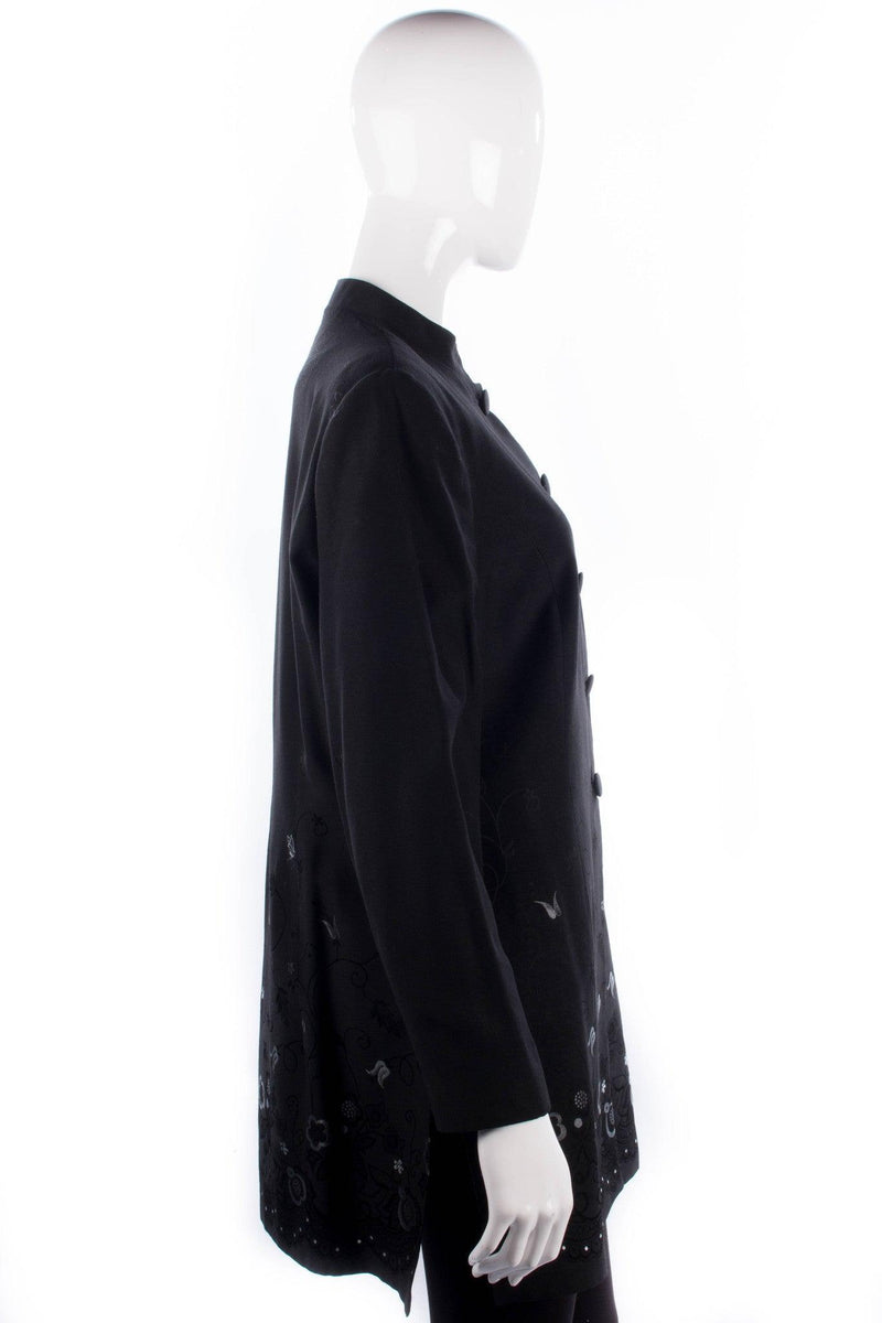 Platinum black mandarin collar long jacket with silver and black floral embroidery. Size 16