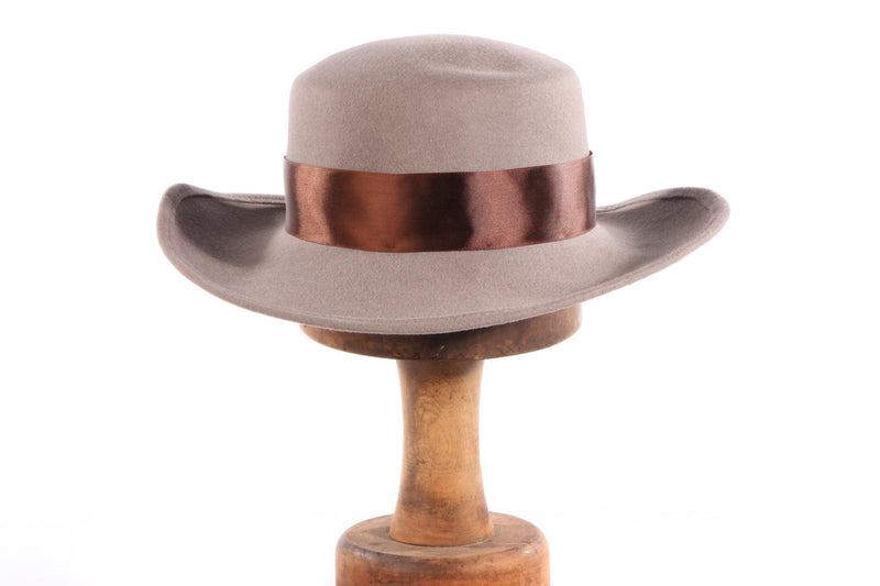 Grey hat with flat back rim and brown bow