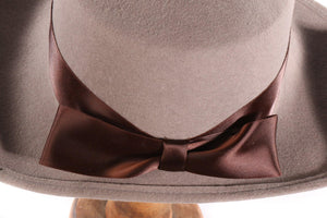 Grey hat with flat back rim and brown bow  detail
