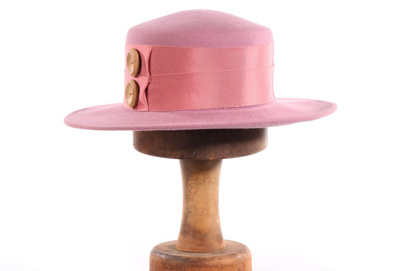 Light pink hat with button detail