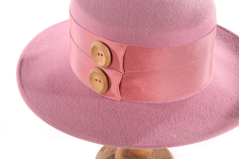 Light pink hat with button detail side