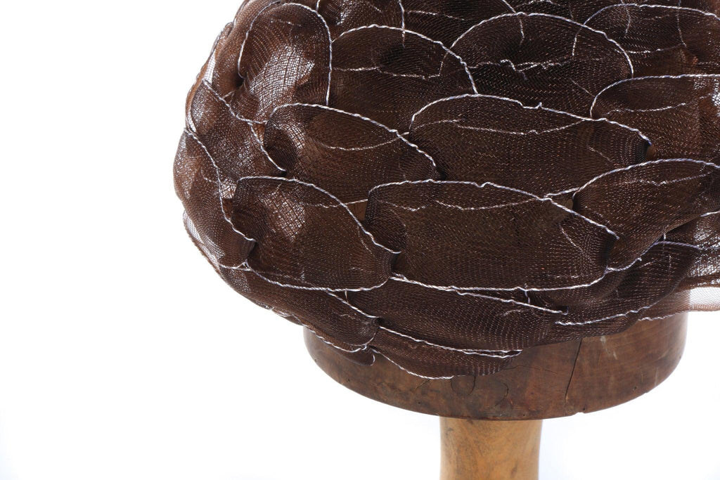 Brown net hat with silver details