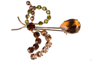 Delicate paste brooch with amber and green stones