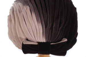 Dark and light coloured hat with bow detail side