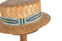 Straw boating hat with blue and yellow ribbon  side