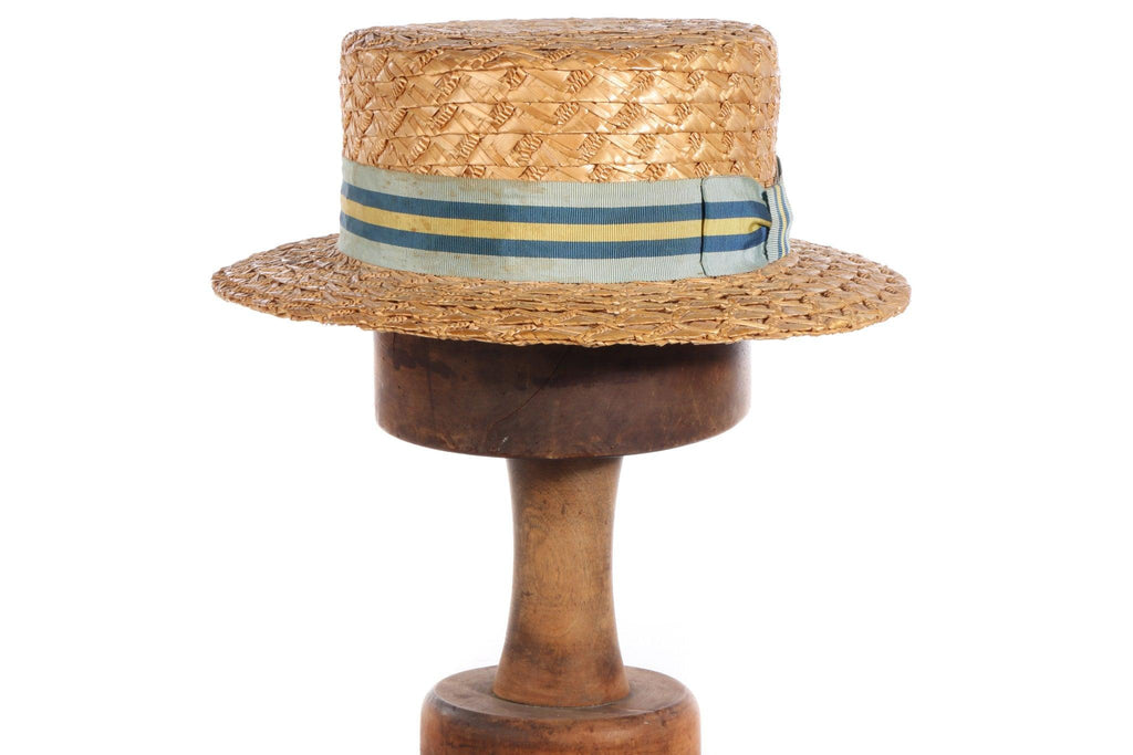 Straw boating hat with blue and yellow ribbon