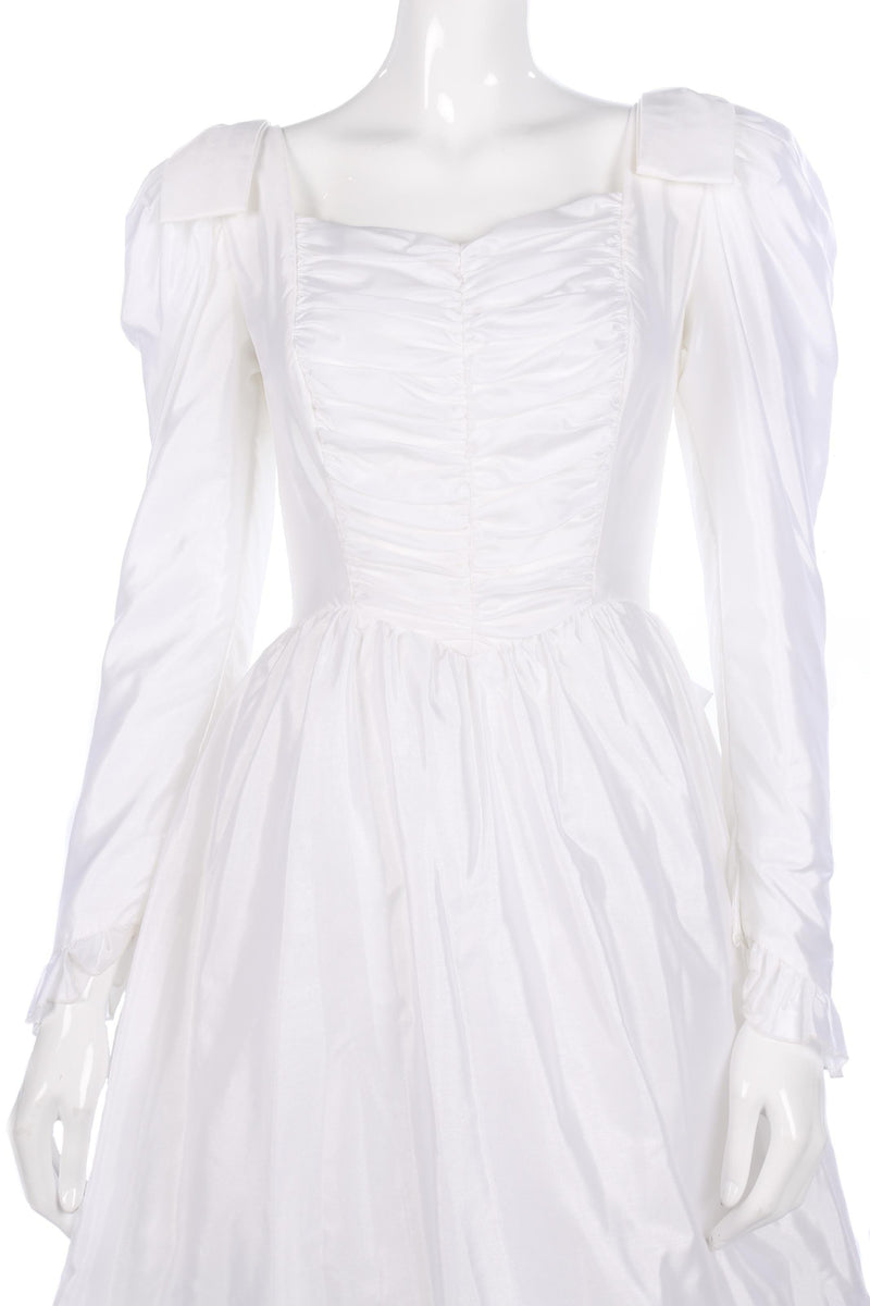 Ronald Joyce white wedding dress with ruffle train