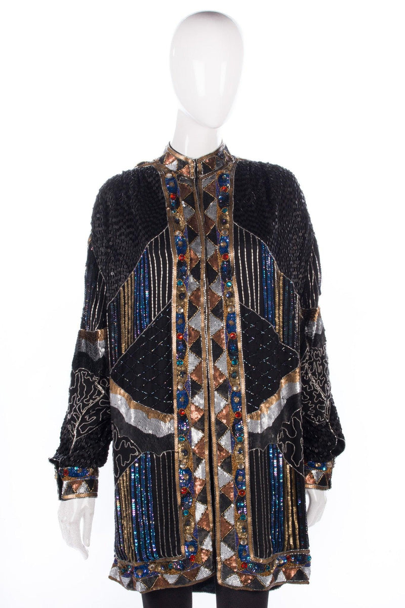 Amazing black, blue and gold beaded jacket with cuffed sleeves. A show stopper.