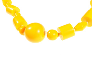 Long yellow beaded necklace detail