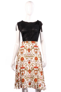 White and red patterned skirt
