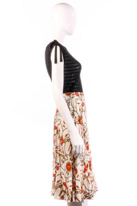 White and red patterned skirt side