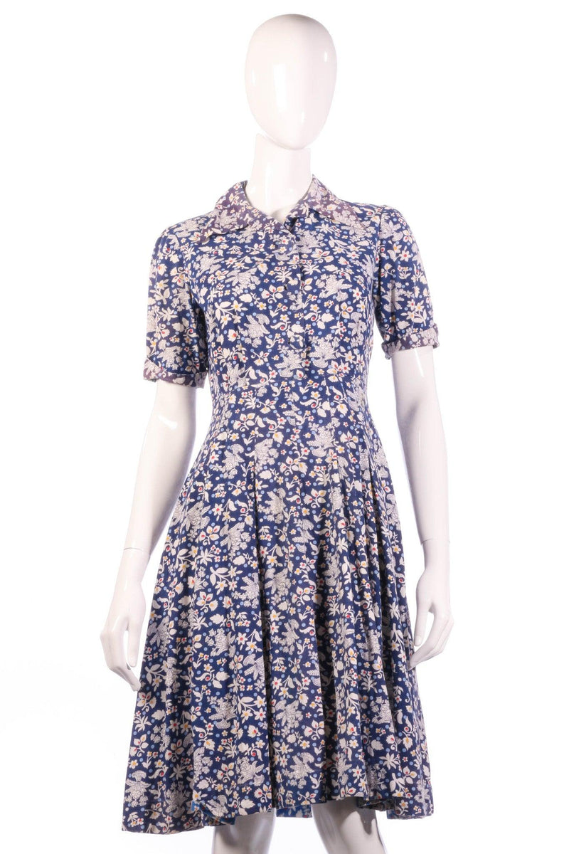 White and blue floral button up dress with collar