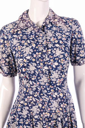 White and blue floral button up dress with collar detail