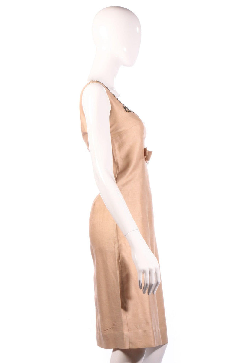 Beige cocktail dress with beaded neckline  side