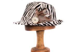 Zebra print hat with feather detail