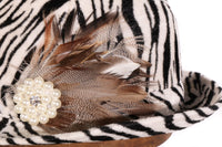 Zebra print hat with feather detail  side