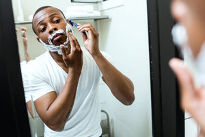 image of a man shaving his beard