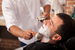 image of a men shaving his beard