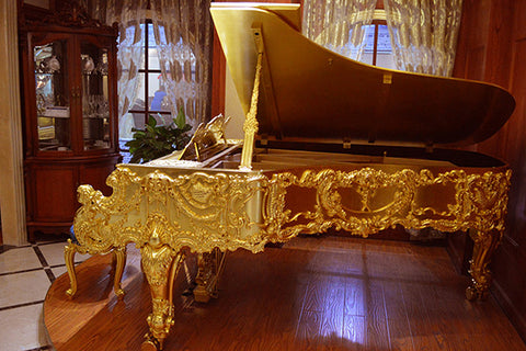 Ornate SteinBecker Gold Grand Piano
