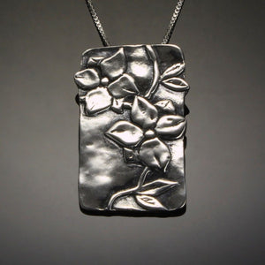 Handmade dogwood pendant in sterling silver