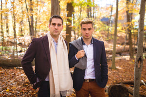 Two Young men wearing Alpaca grey scarf made of 100% Peruvian baby alpaca wool