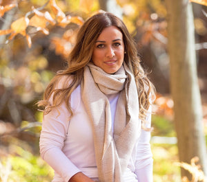 young woman wearing an alpaca scarf with design from andes made of 100% Peruvian baby  alpaca wool