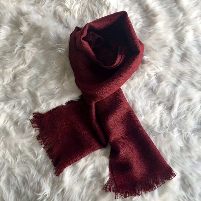 Wood Valet with clothes for men including a burgundy alpaca scarf handmade of 100% Peruvian alpaca wool