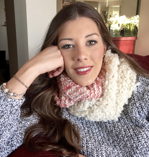 Young woman with an alpaca eternity scarf coral and beige handmade of 100% Peruvian alpaca wool