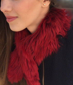 YOUNG WOMAN WITH AN ALPACA FUR SHORT SCARF RED made of 100% suri Peruvian alpaca fur
