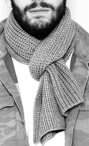 Young man wearing  an Alpaca scarf Grey knitted handmade of 100% Peruvian alpaca wool