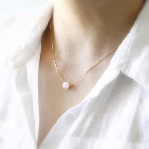 gold floating pearl necklace
