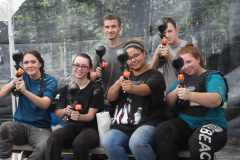 group of people sitting on table at boss paintball fields