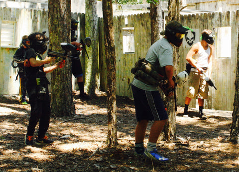 entire team getting ready for a game of paintball in george town city melee at boss paintball fields