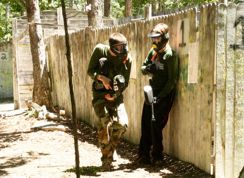 cautiously taking a corner at building 1 in george town city melee at boss paintball fields