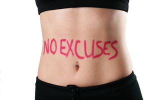 slim waist with 'no excuses' written on stomach
