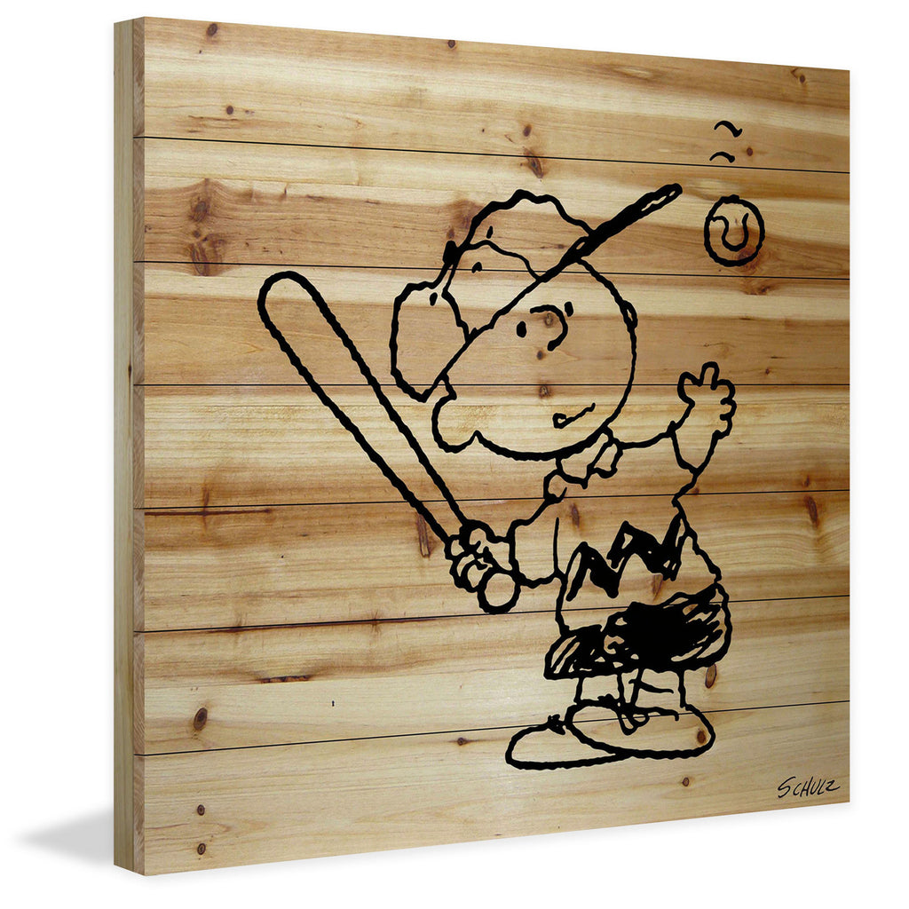 Charlie Brown hits a baseball printed in black on natural wood