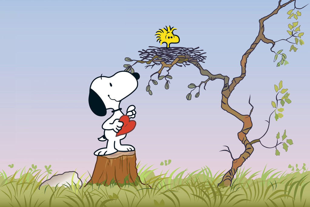 Snoopy bringing a heart to Woodstock's nest