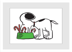 Snoopy eats candy canes from bowl